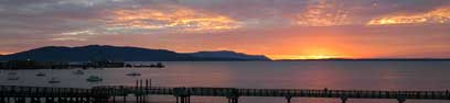 The view of a sunset over Bellingham Bay as you are looking at the San Juan Islands from Keenan's at the Pier.