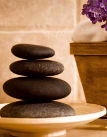A plate of balanced hot stones are ready to provide much needed muscle release for the next client