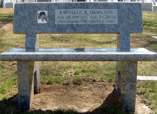 Example of a memorial bench dedicated to one person (sometimes allowed in publi parks as well as cemeteries).