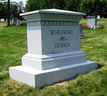 A mult-i level headstone with a sturdy base