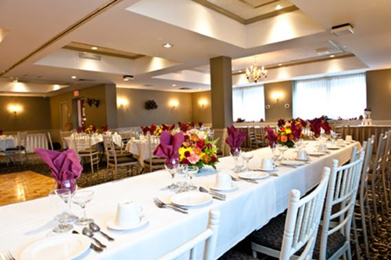Photo of Manor Inn banquet room with table settings for a wedding reception