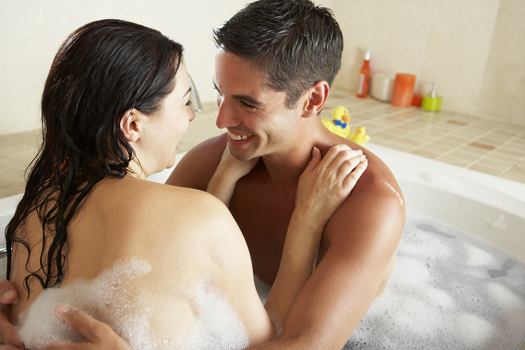 Happy couple in a hot tub