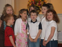 Children singing at a church event