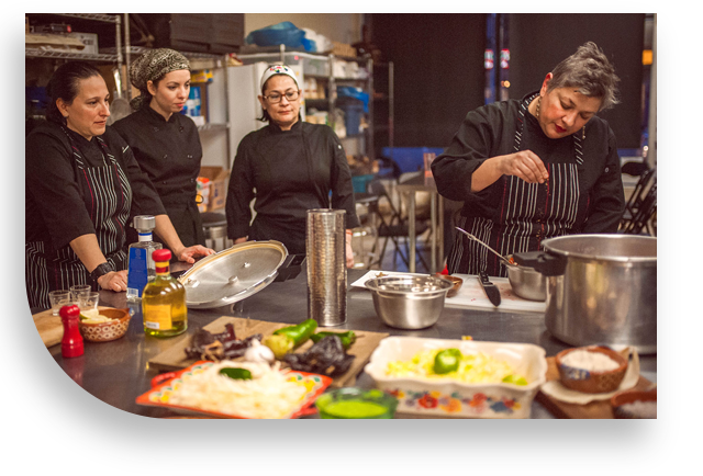 cooking, studio, adriana, pelayo, paola, solorzano, tequila, pepper, mill, red, glasses, chili, garlic, lettuce, kitcken, apron, black, stripes, white, women, pots, knife, table, green, rice, cutting, board, fridge, santo, pecado, mexican, catering, toronto, canada