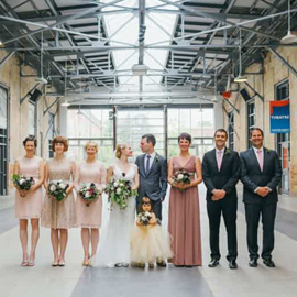 wedding couple with bridesmaids and best man