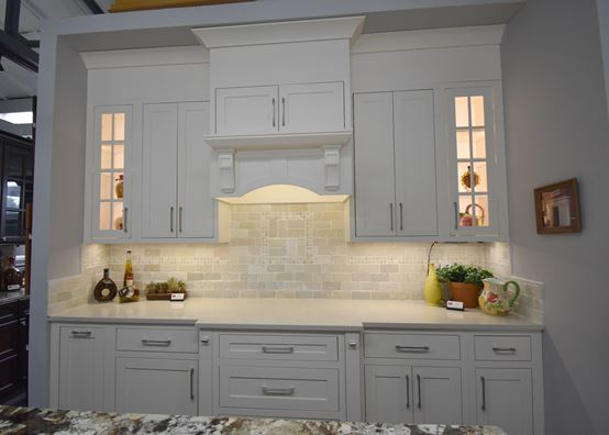Impressive white cabinets with a tile wall