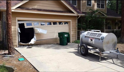 This is probably one of the most severely damaged garage doors we have seen thanks to a bear.