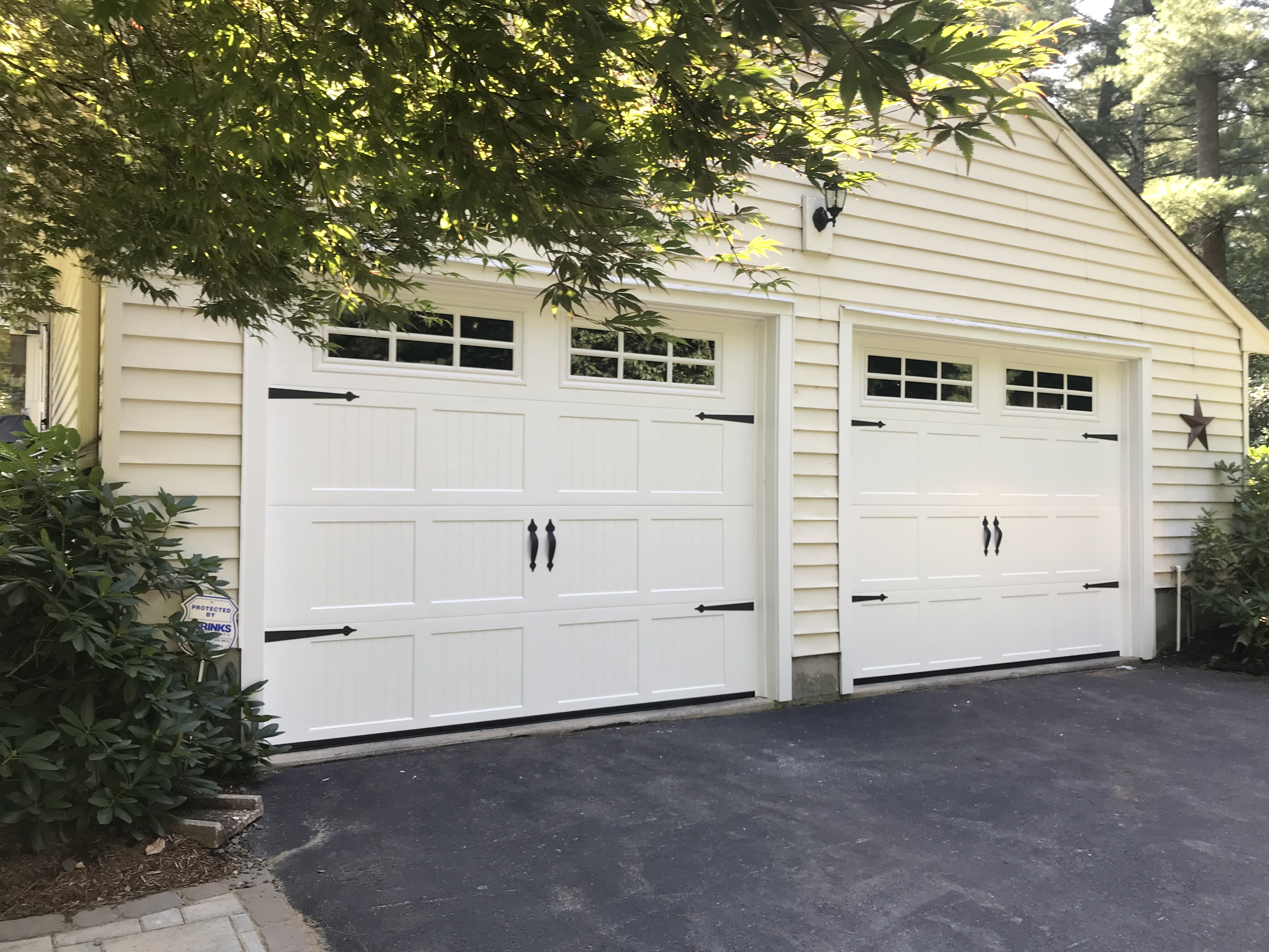 3 car garage with remote controlled doors