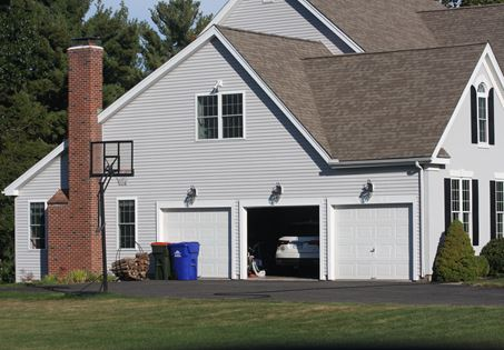 We install beautiful garage doors and teach you how to use a remote control
