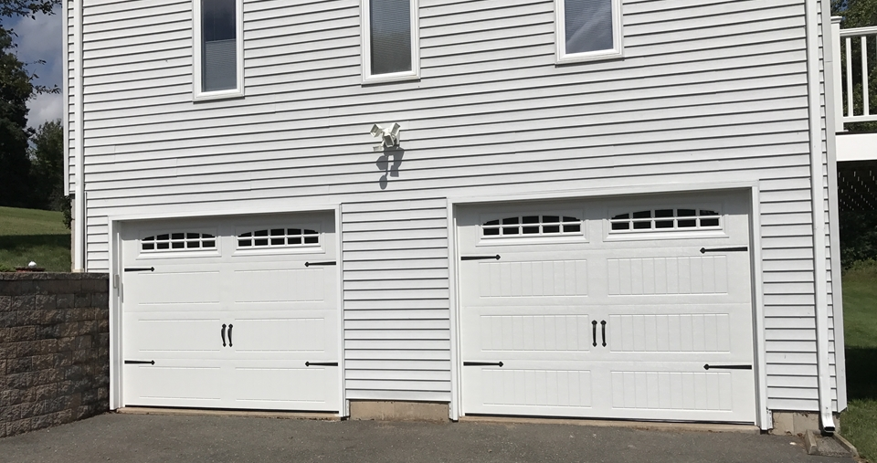 Keep your Burlington home safe and secure with remotely operated garage doors.