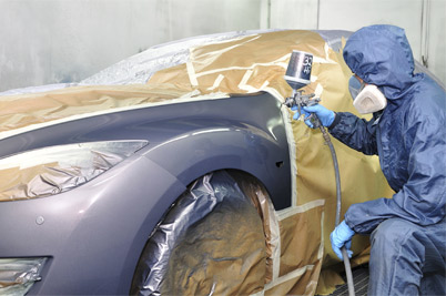 Technician in an automotive spray paint booth