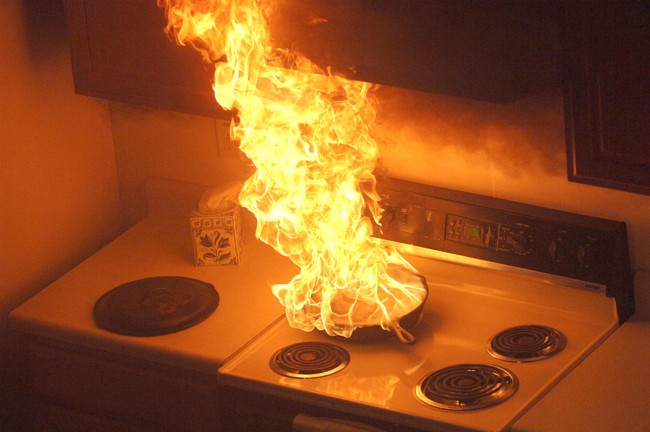 Kitchen fire starting on a stovetop