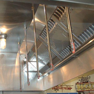 Fire protection hood in a commercial kitchen