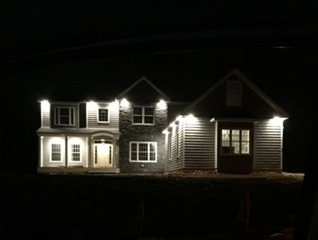 Enjoy the beauty and safety of a home lit up at night