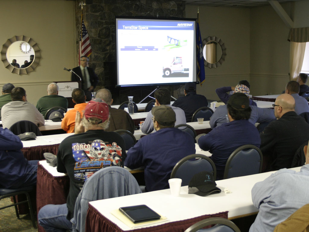 A video presentation at a truck fleet seminar