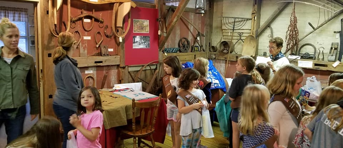A Brownie troop visits the Plainville Historical Society Museum