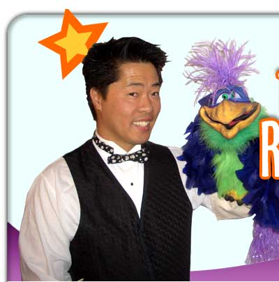 robert in a tuxedo with a funny bird puppet