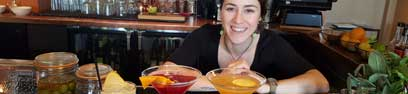 Nichole our bar manager serving up cocktails to patrons of happy hour.