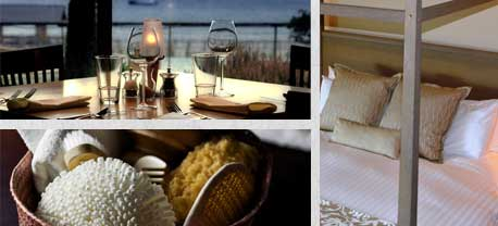A grouping of three pictures. The first a table set with flatware, wine, water glasses overlooking Bellingham bay. The second a basket with various spa items, and thirdly a king bed with white down comforter and pillows.