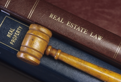 Photo of real estate law books and gavel