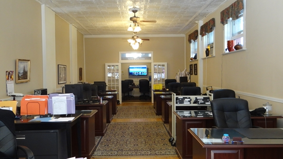 View of desks and conference room at Realty Group of New England, Naugatuck