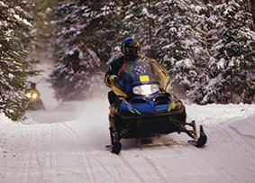 SNOWMOBILING/ SKIING